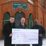 Leon recives a cheque from Bovis